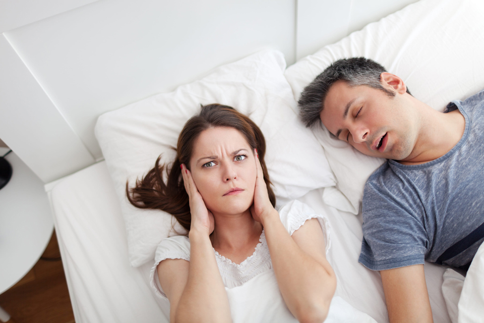 Woman struggling to sleep becasue husband is snoring